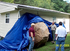 A huge boulder smashed into a Kentucky home