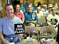 Residents of Dendron, Virginia, opposing a new coal-fired power plant proposed for their town